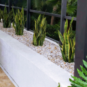 Custom residential planting with river rock